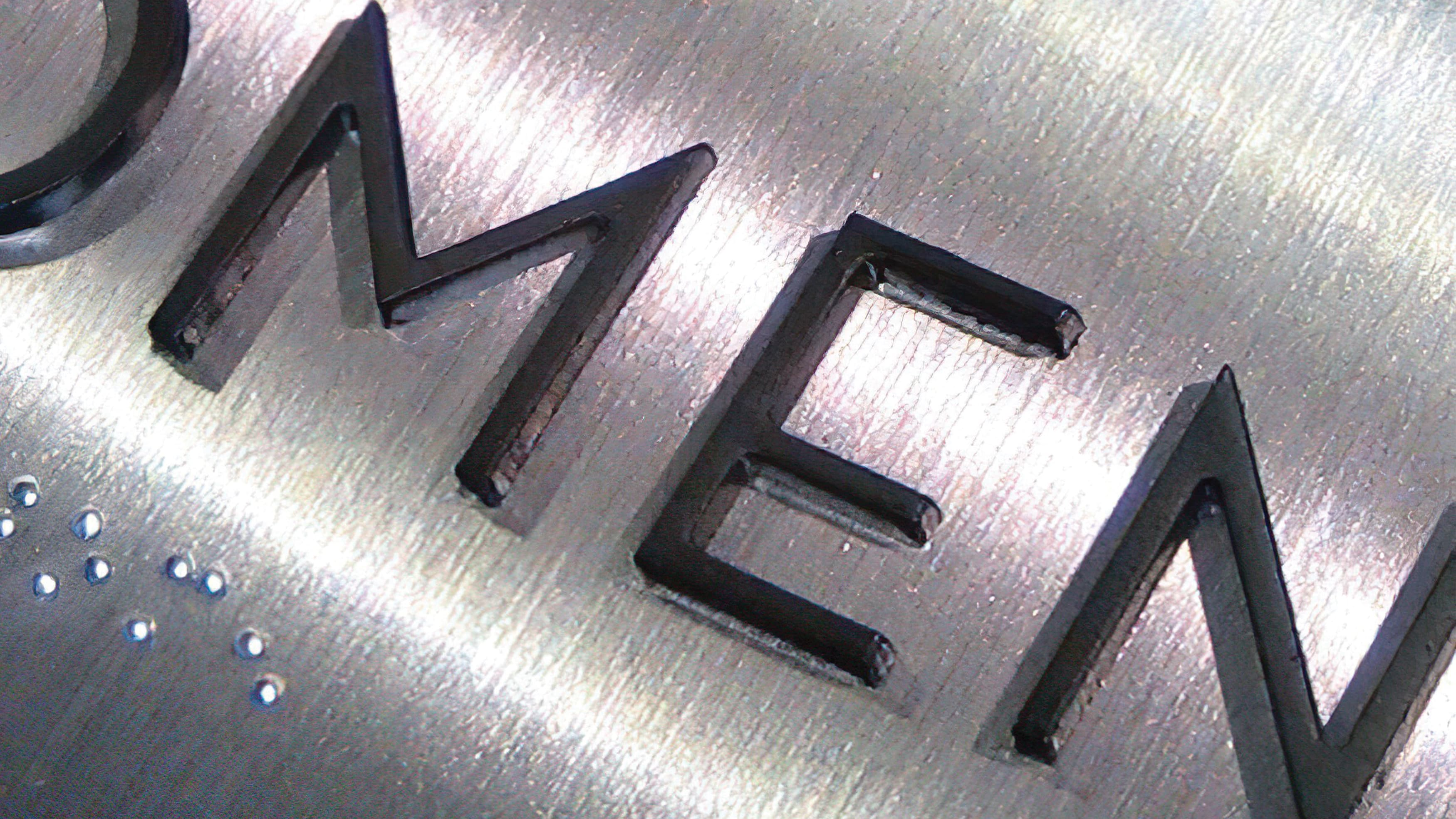 Detail photograph of ADA Compliant tactile signage