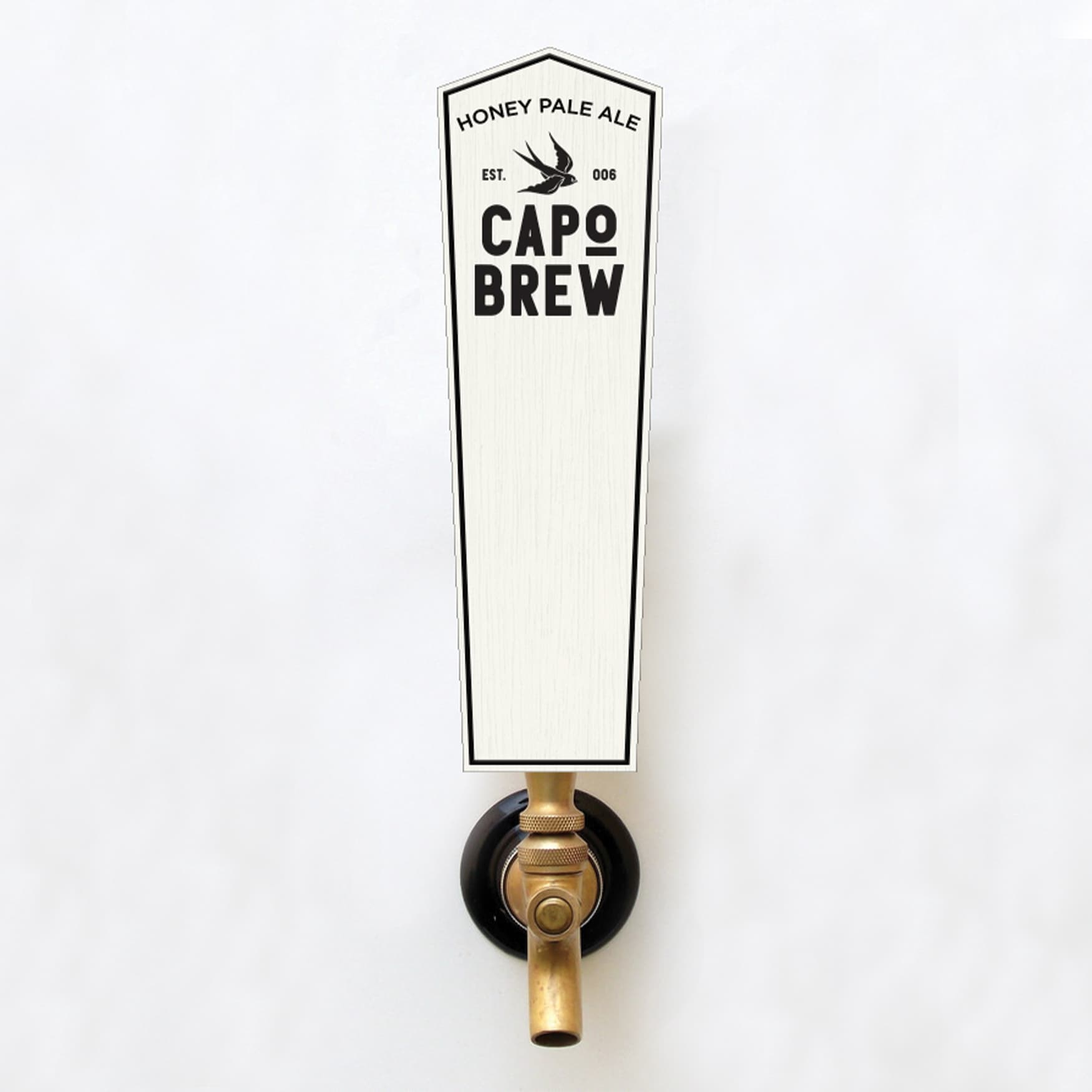 Capo Brew branded pint glass being filled with a beverage