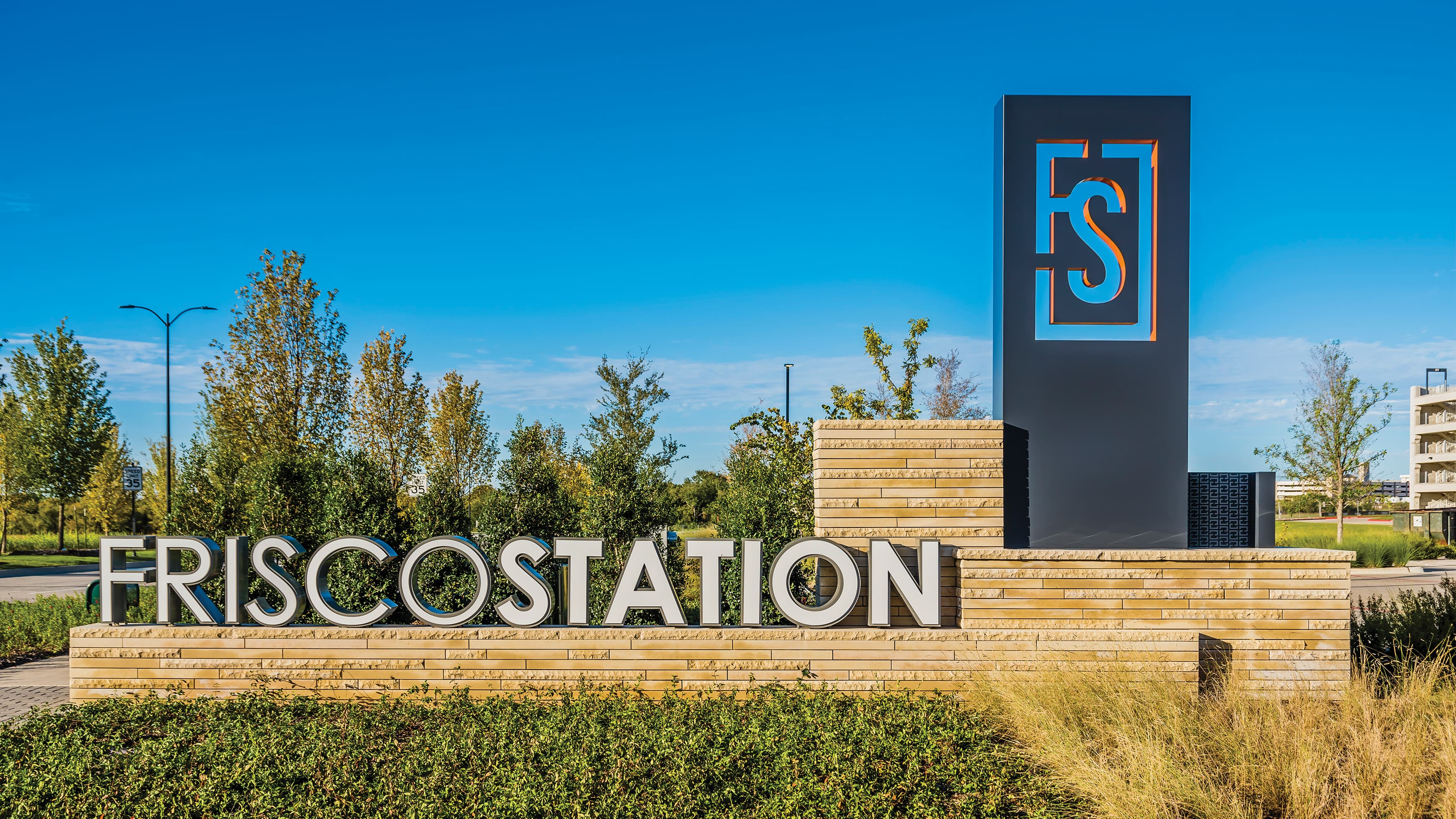 Monument Signage at the mixed-use Frisco Station project in Frisco, Texas