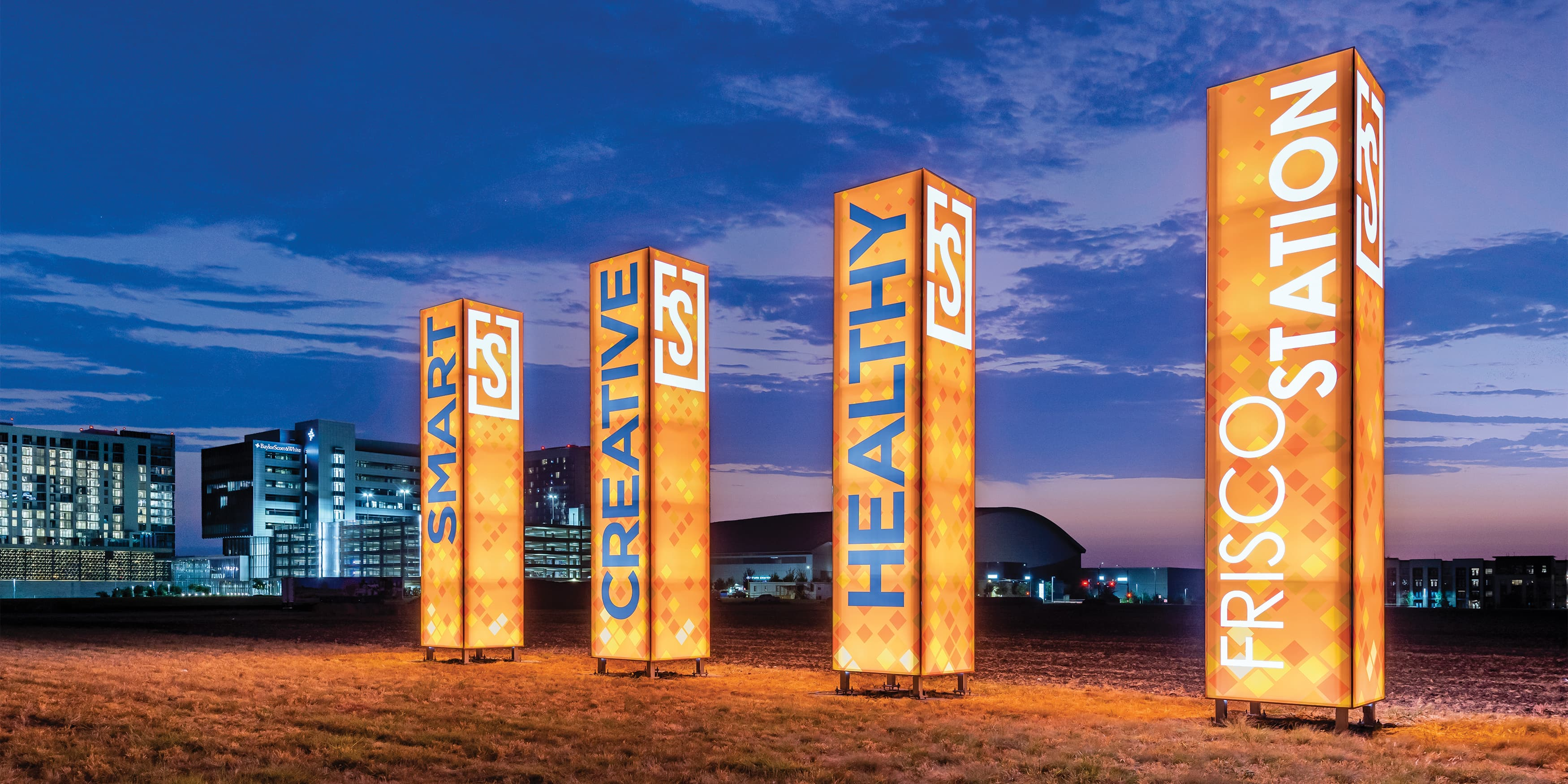 Frisco Station, a mixed-use project in Frisco, Texas, branded project totem