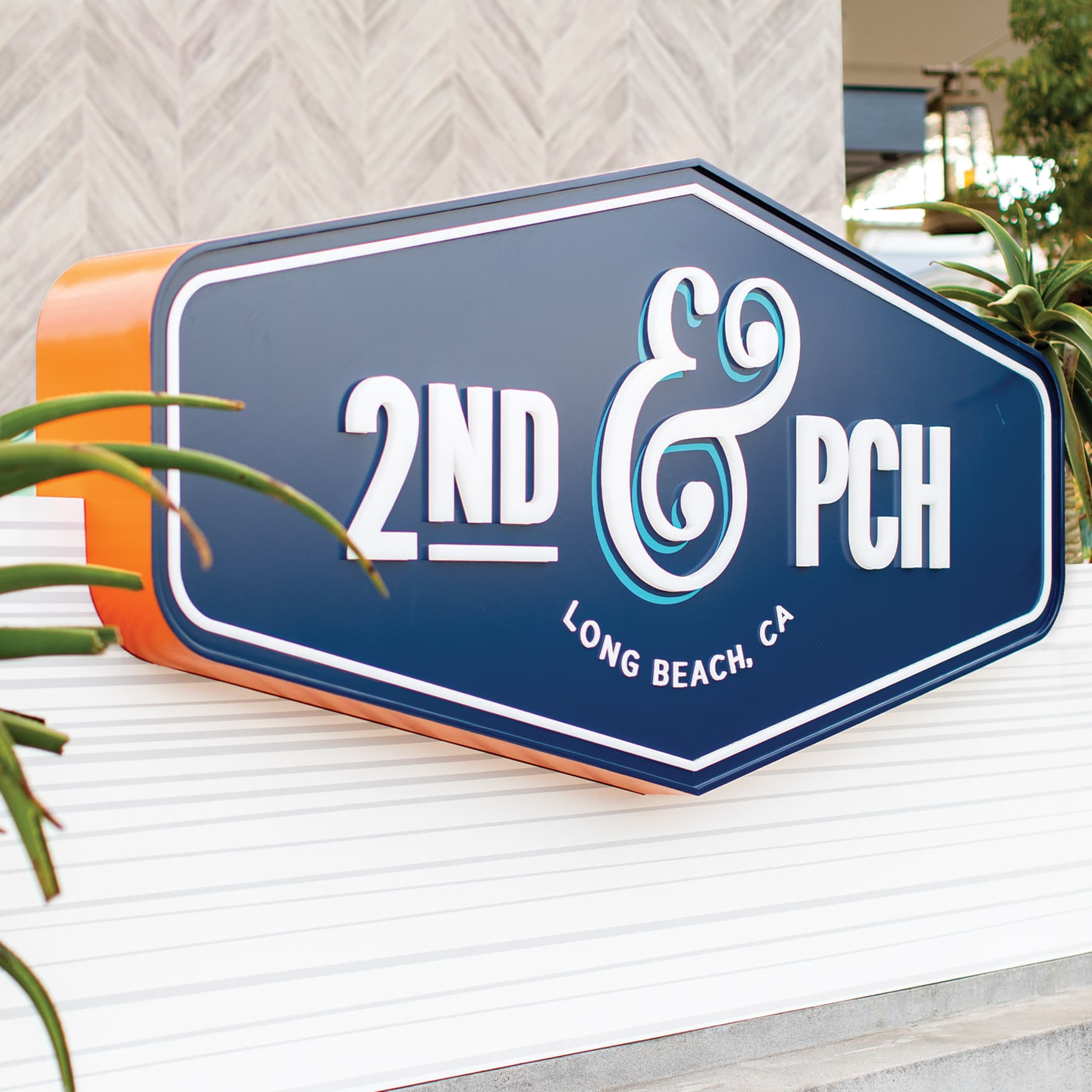 2nd & PCH blue and orange identity signage in Long Beach, California