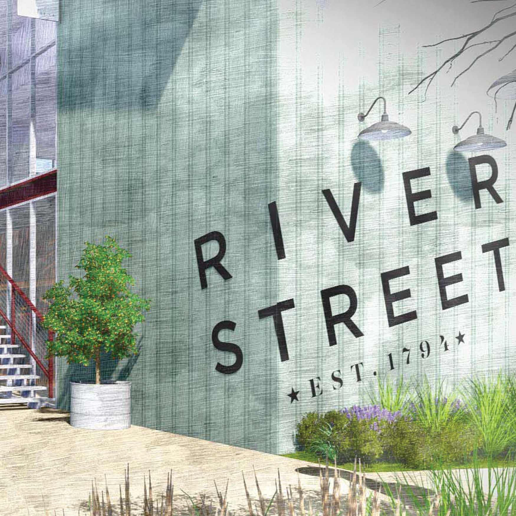 """River Street"" branded wall identity, crossing two faces of perpendicular walls"