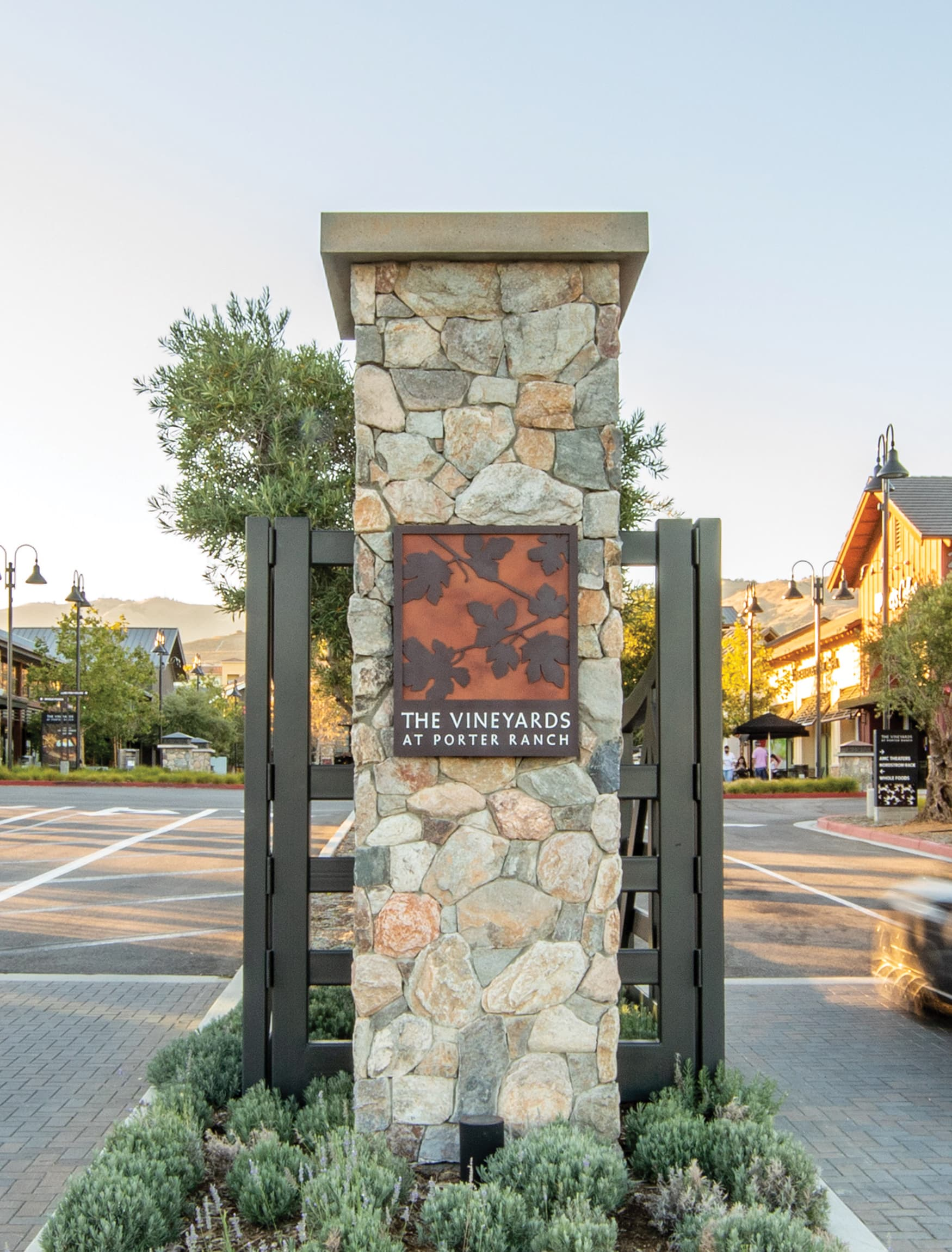 The Vineyard at Porter Ranch project monumentation gateway with project identity plaque.
