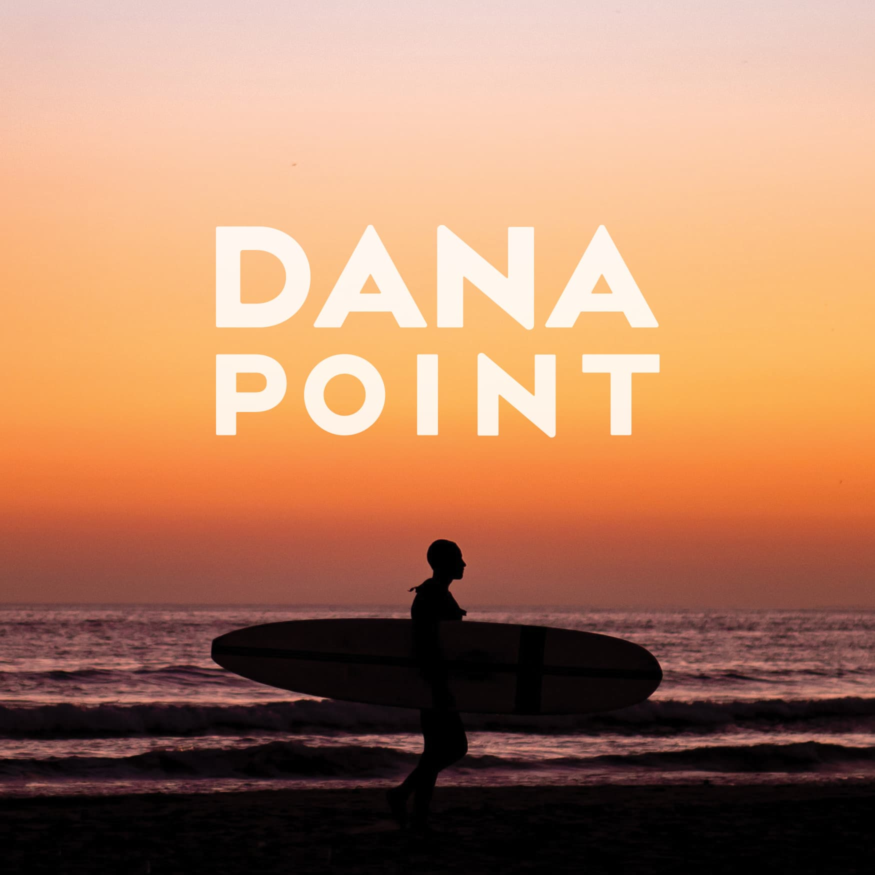 Shadow of a surfer at sunset with the words DANA POINT written above him.