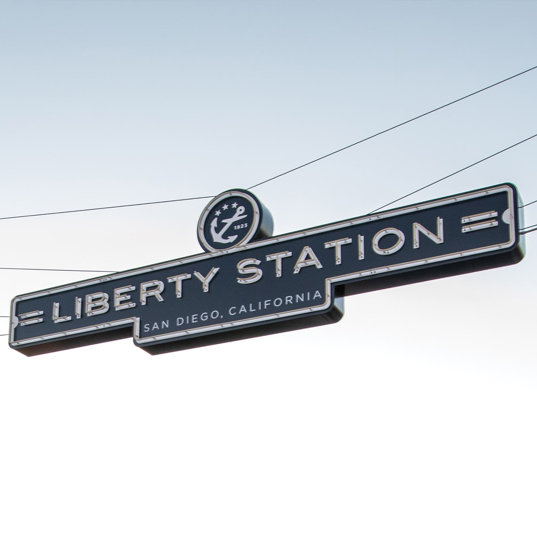 Liberty Station entrance neon signage suspended across the street