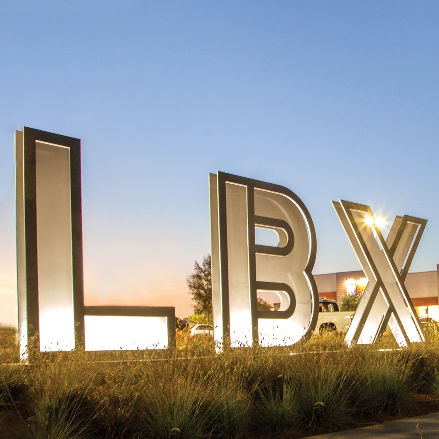 Long Beach Exchange monument large letter signage illuminated at dusk