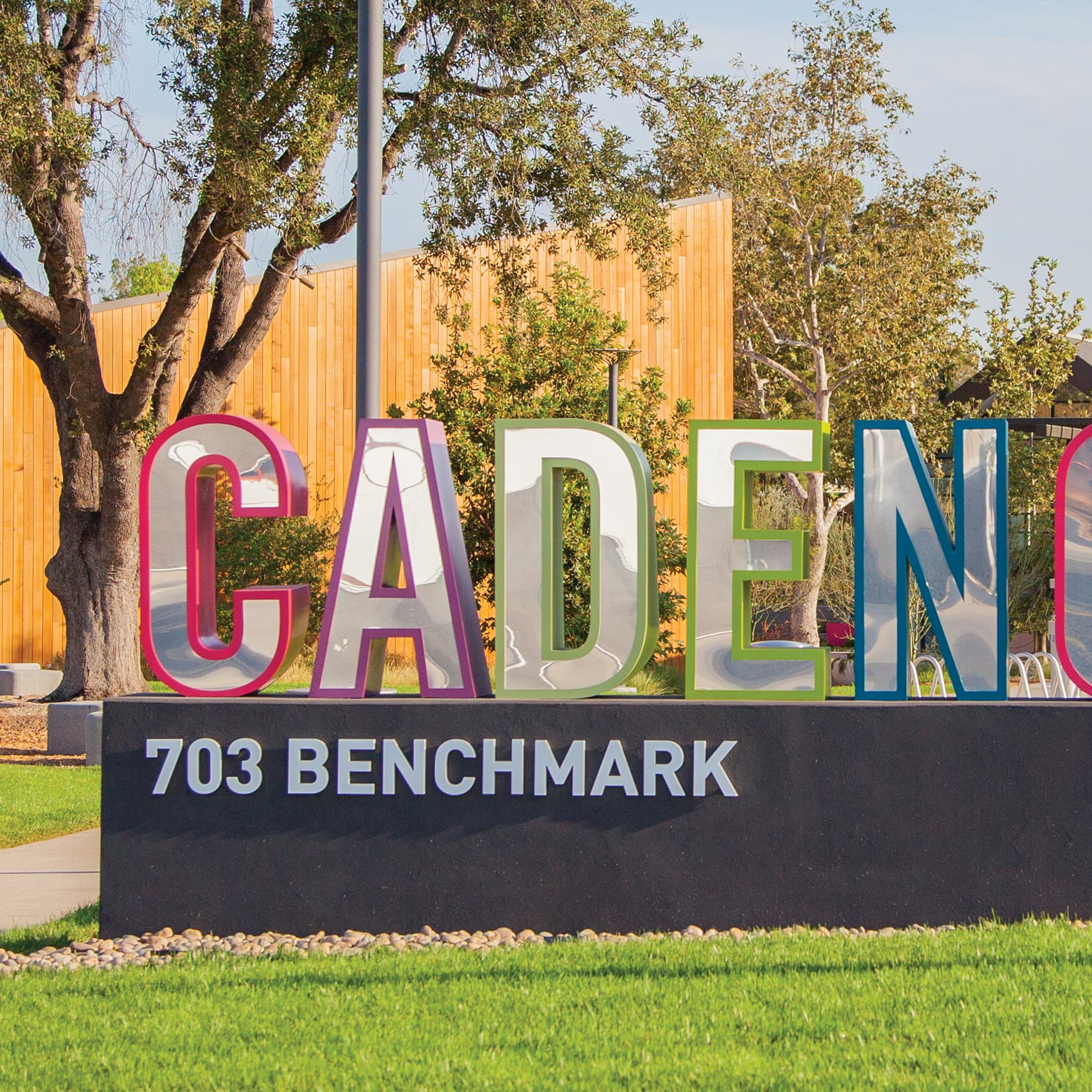 An image of a horizontal monument identity with playful coloring at Cadence Park.