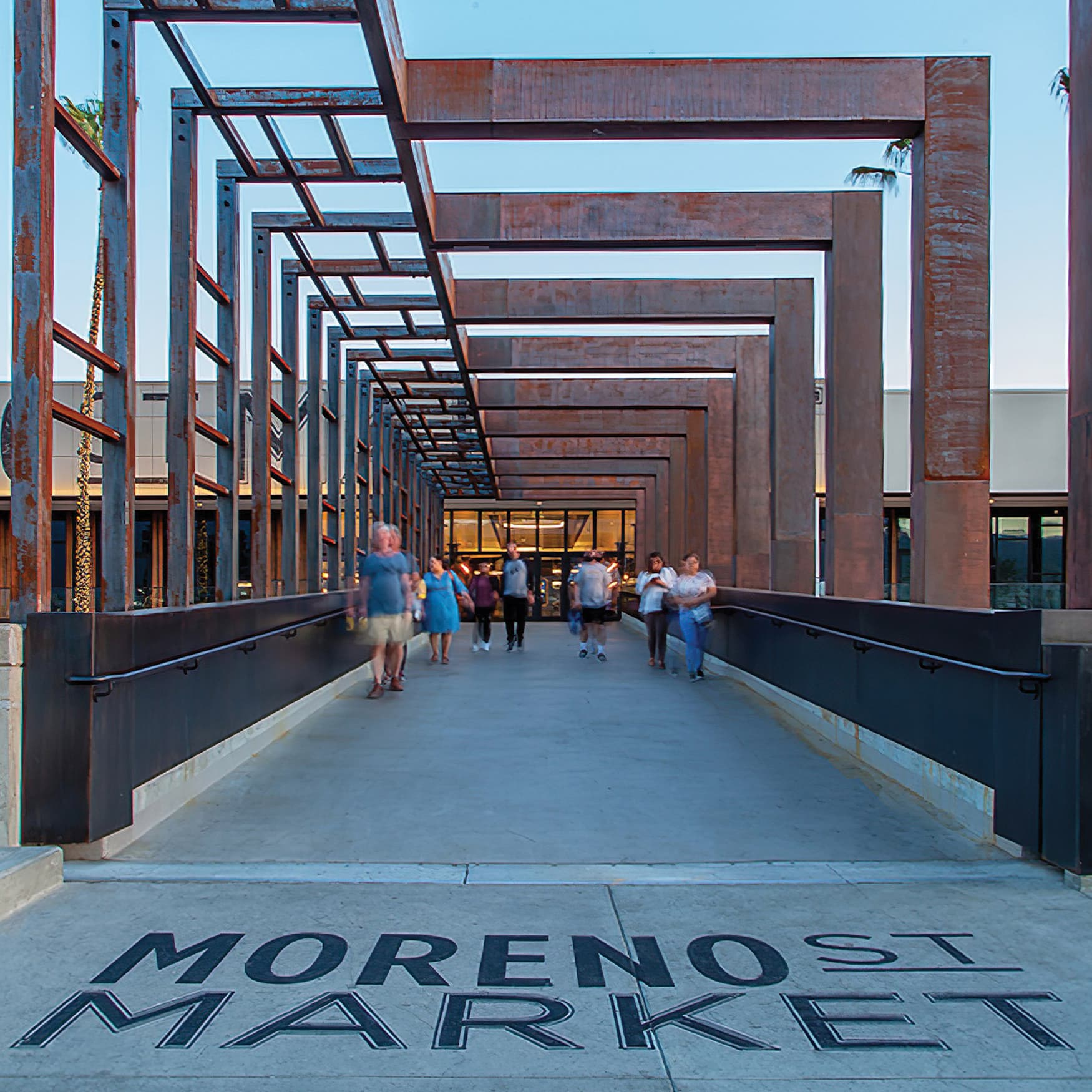 A rustic design aesthetic with painted sign identity on pedestrian walkway into Moreno St Market at Montclair Place