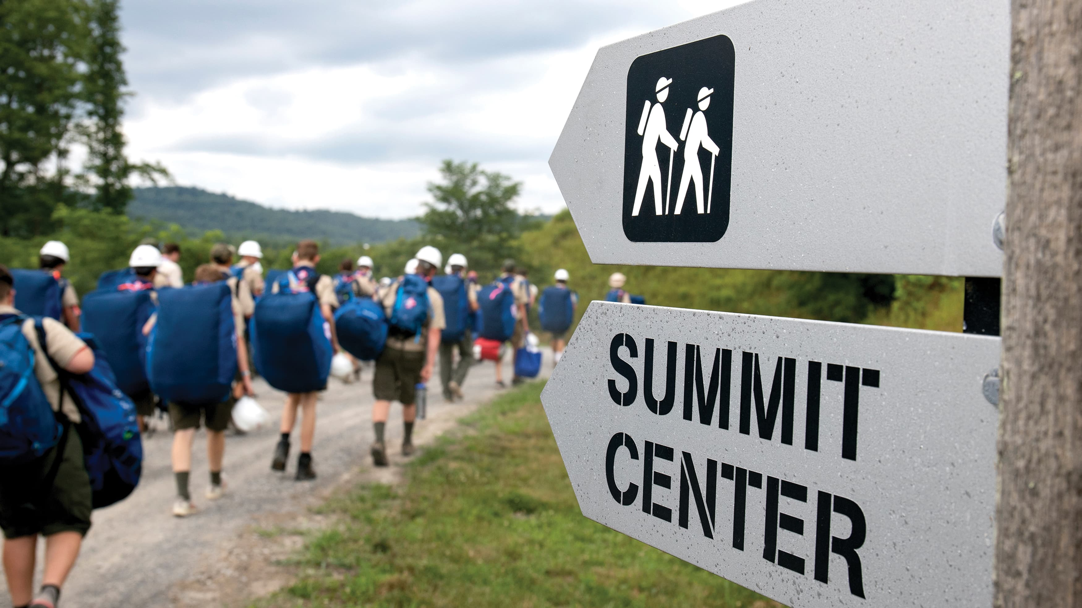 Boy Scouts at Outdoor Camp with Wayfinding signs