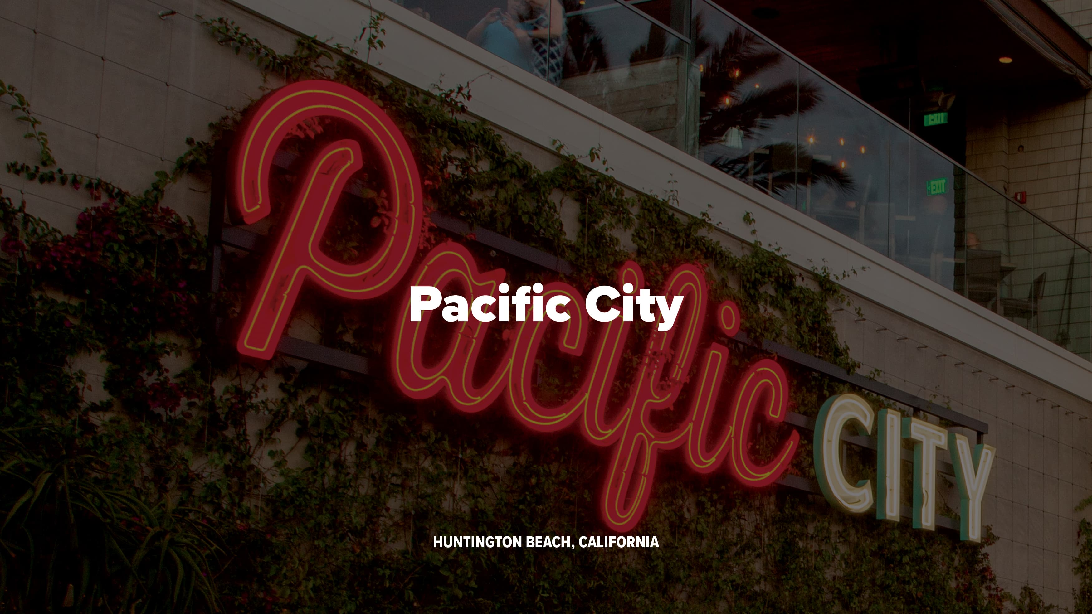 Pacific City branded open-face channel letters mounted to a landscaping wall