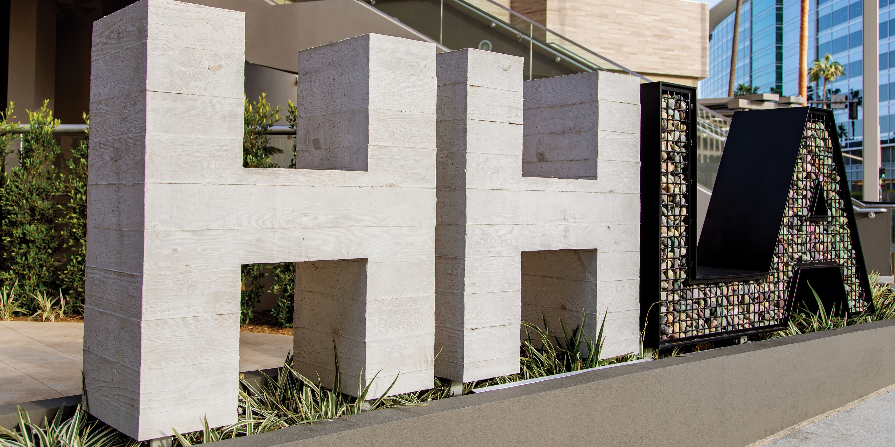 HHLA branded project identity monument