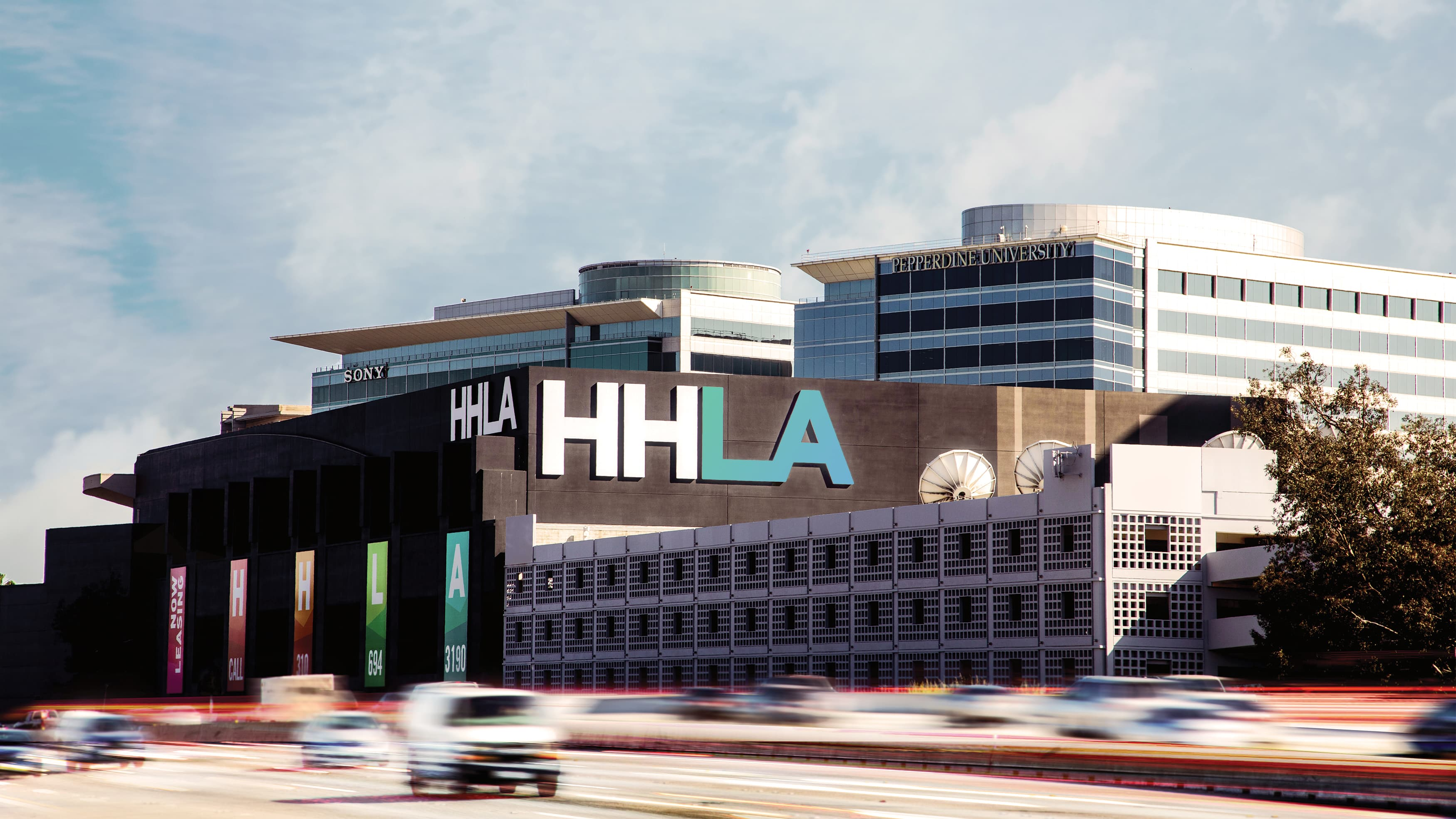 HHLA project from across the 5 freeway, with giant identity facing outward.
