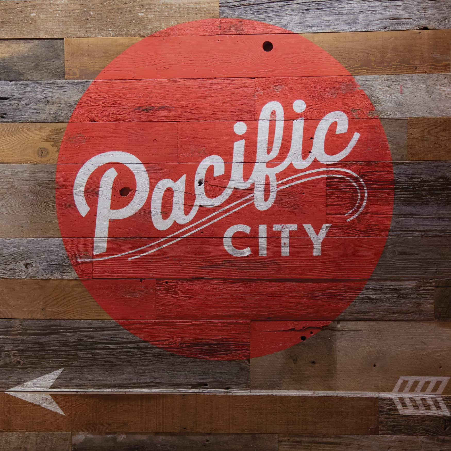 Pacific City waterfront retail project painted identity graphic