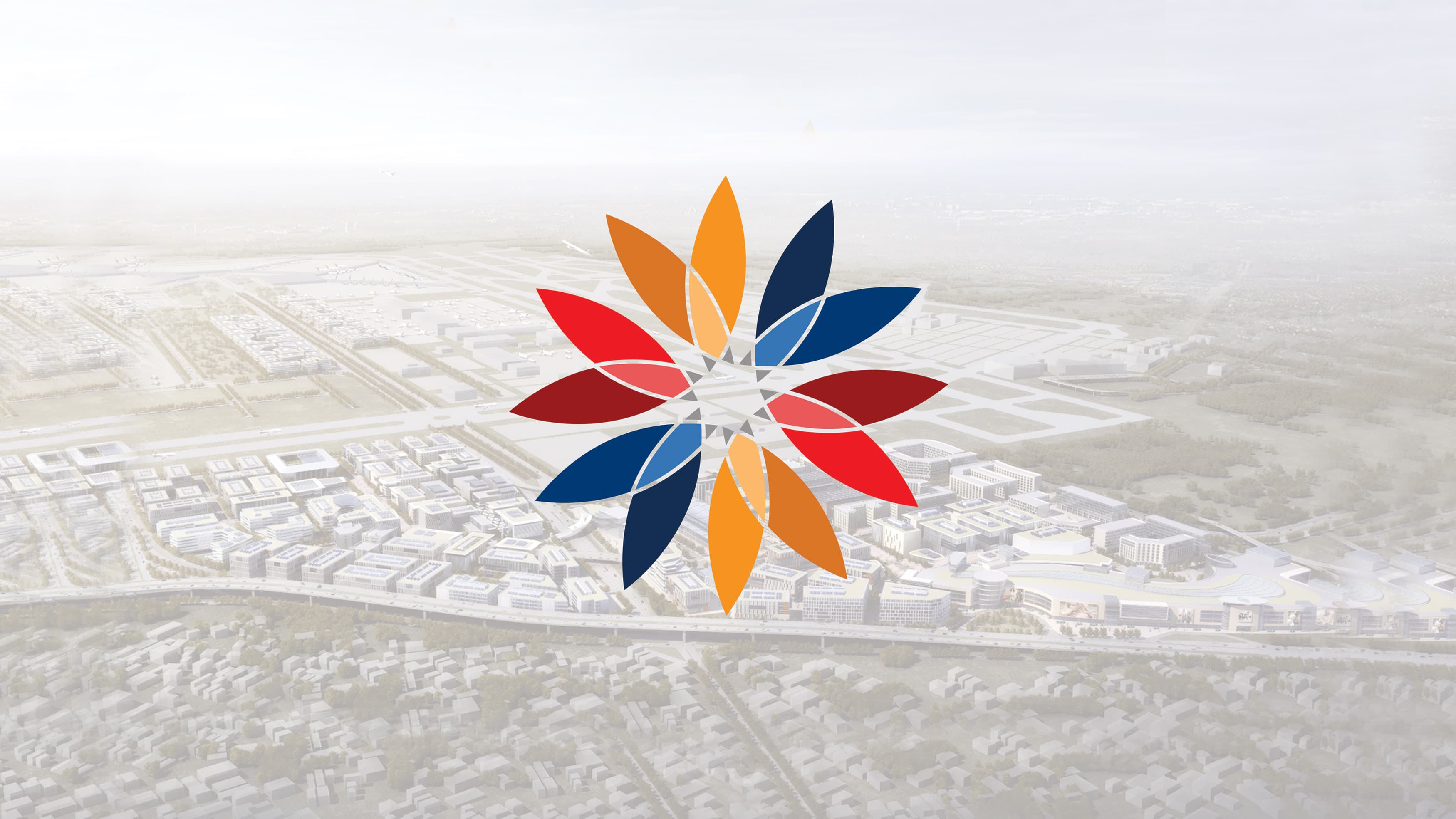 Circular kaleidoscope like logo placed on an aerial image of a city.