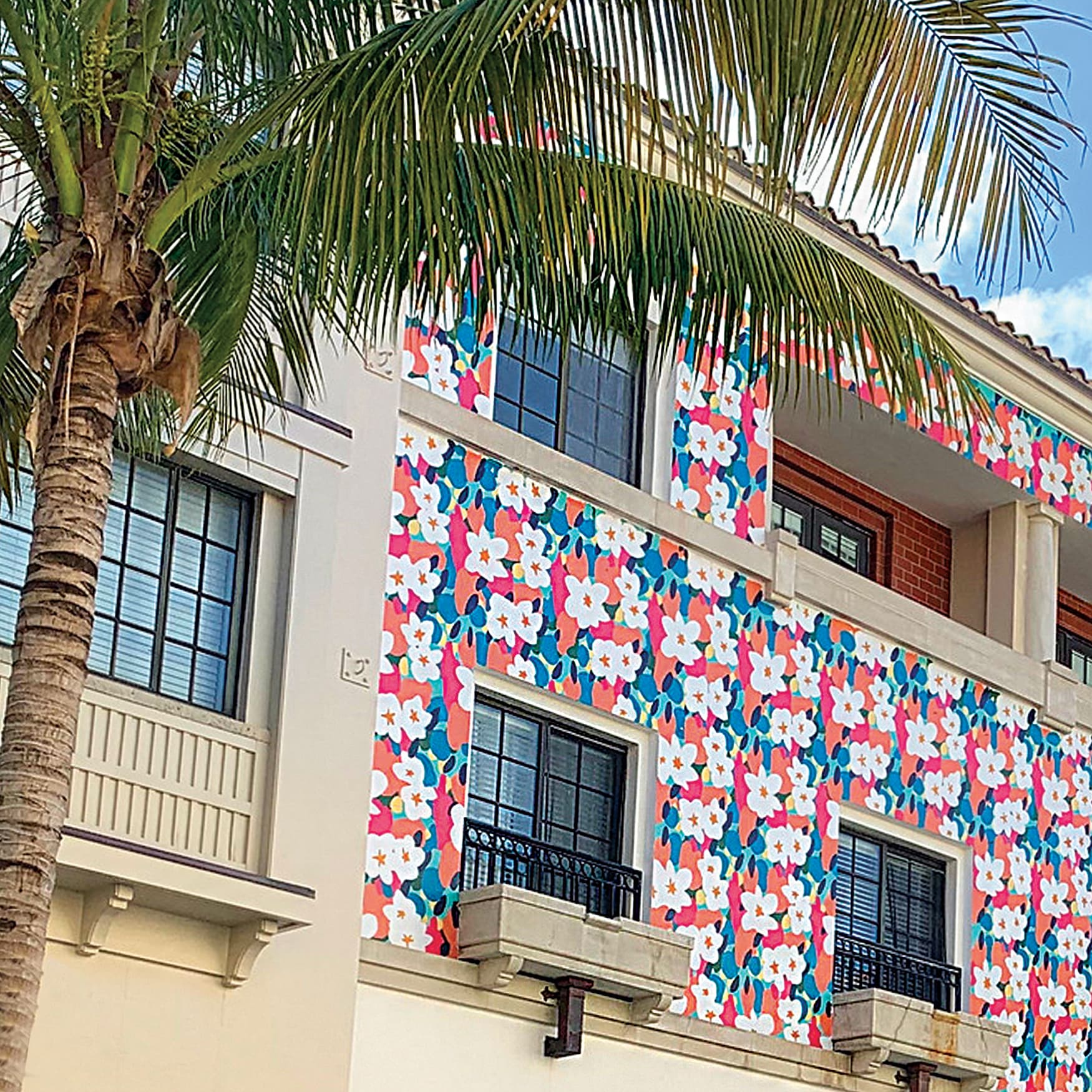 Floral pattern painted on architectural facade of retail center in Florida.