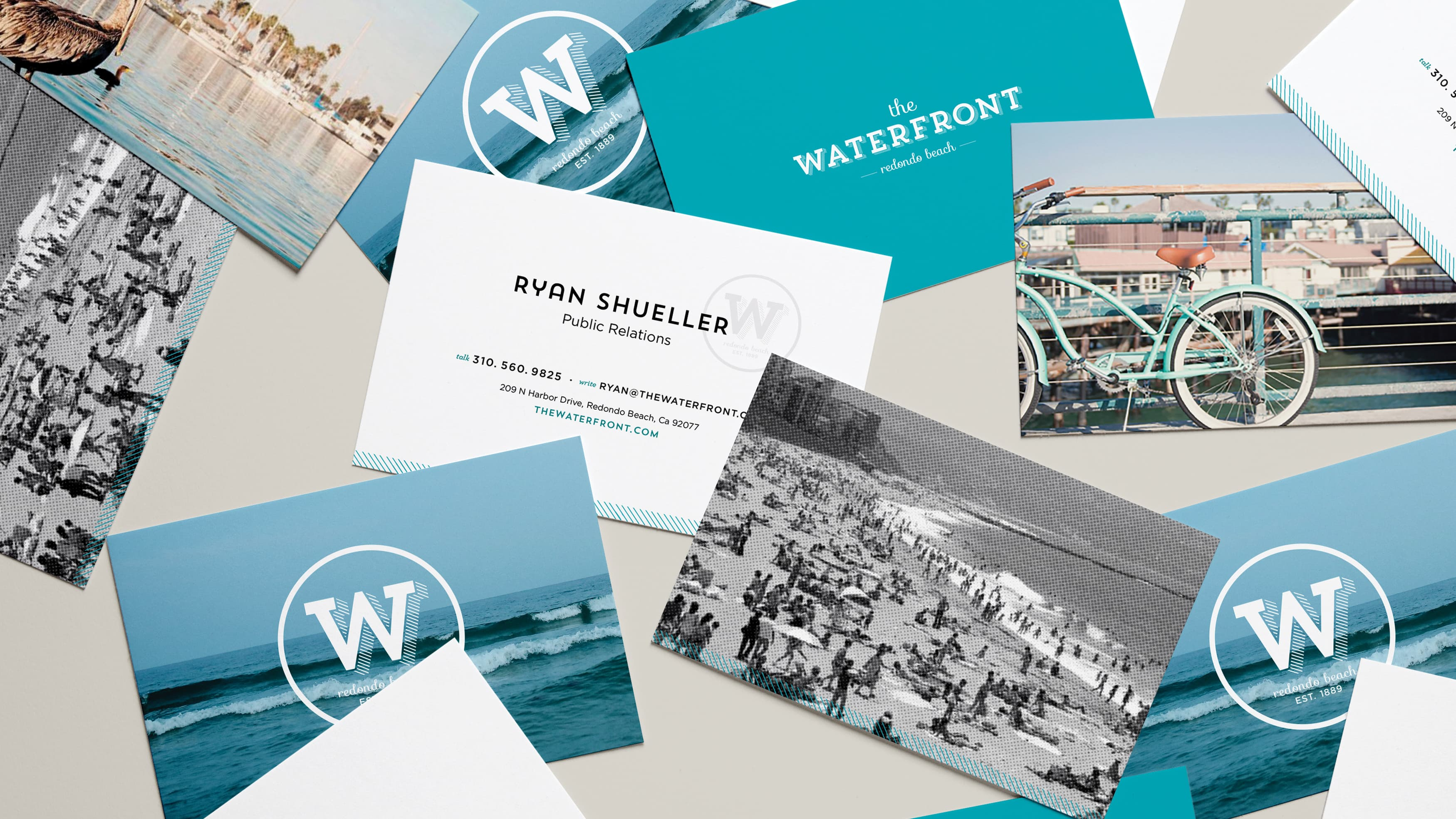 Logo design for CenterCal Properties' The Waterfront on postcards on a table.