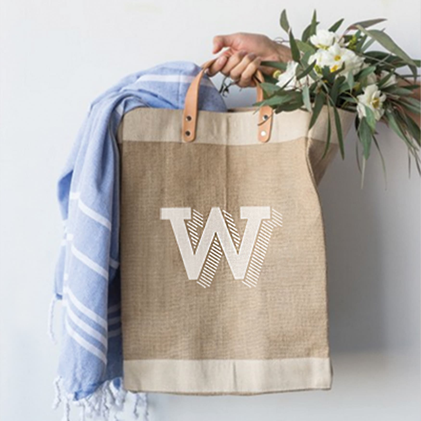 Logo design for CenterCal Properties' The Waterfront on burlap bag with flowers.