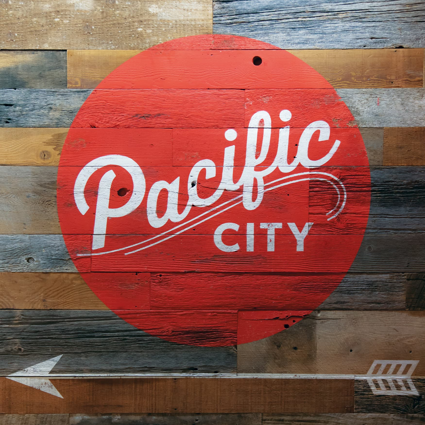 Pacific City painted identity and wayfinding on reclaimed wood designed by RSM Design