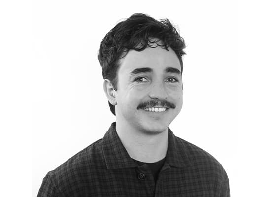 Headshot of RSM design team member Maxwell Helm in black and white.
