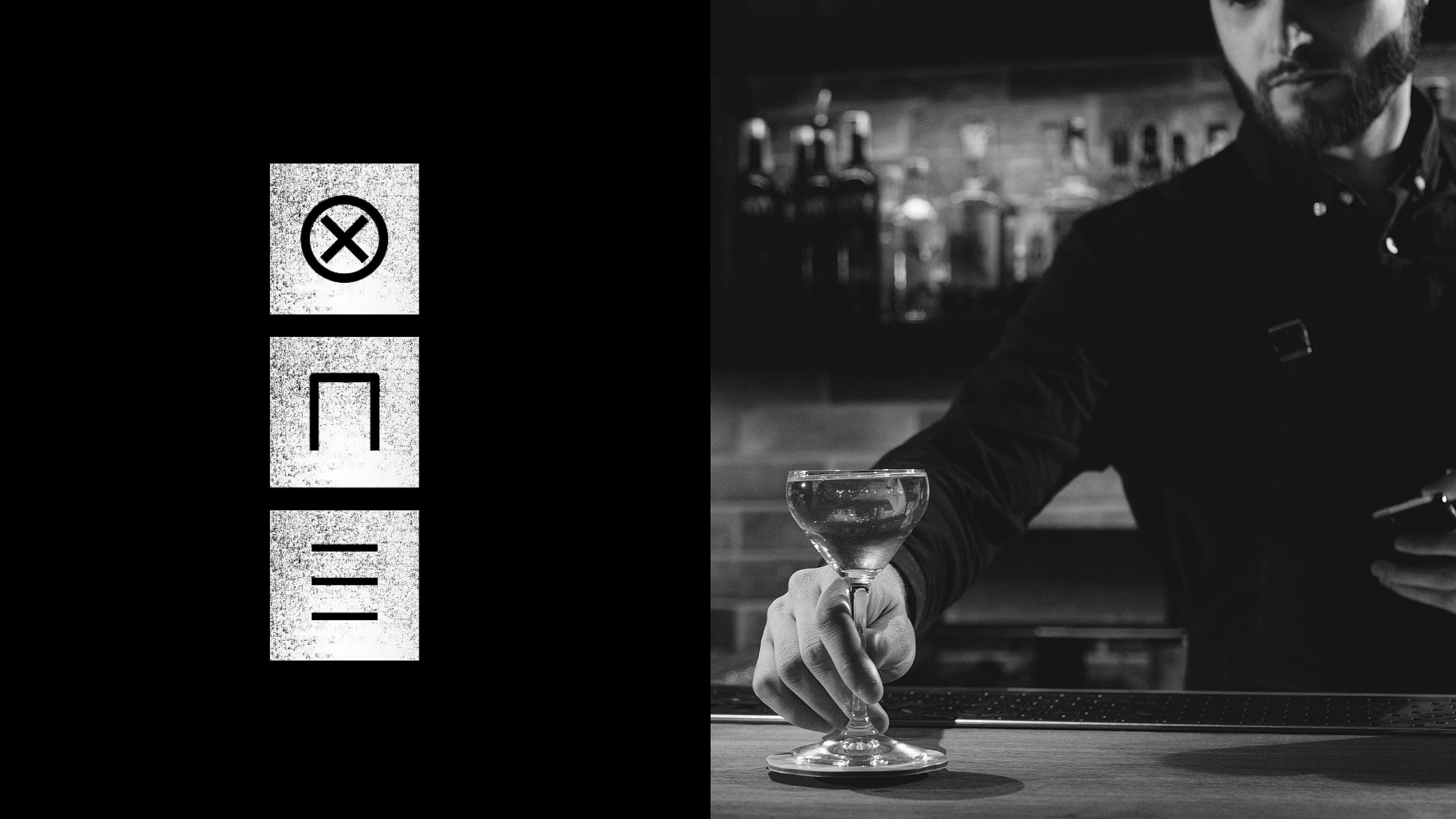 Bartender placing a drink on the counter besides a logo design for Platform One.