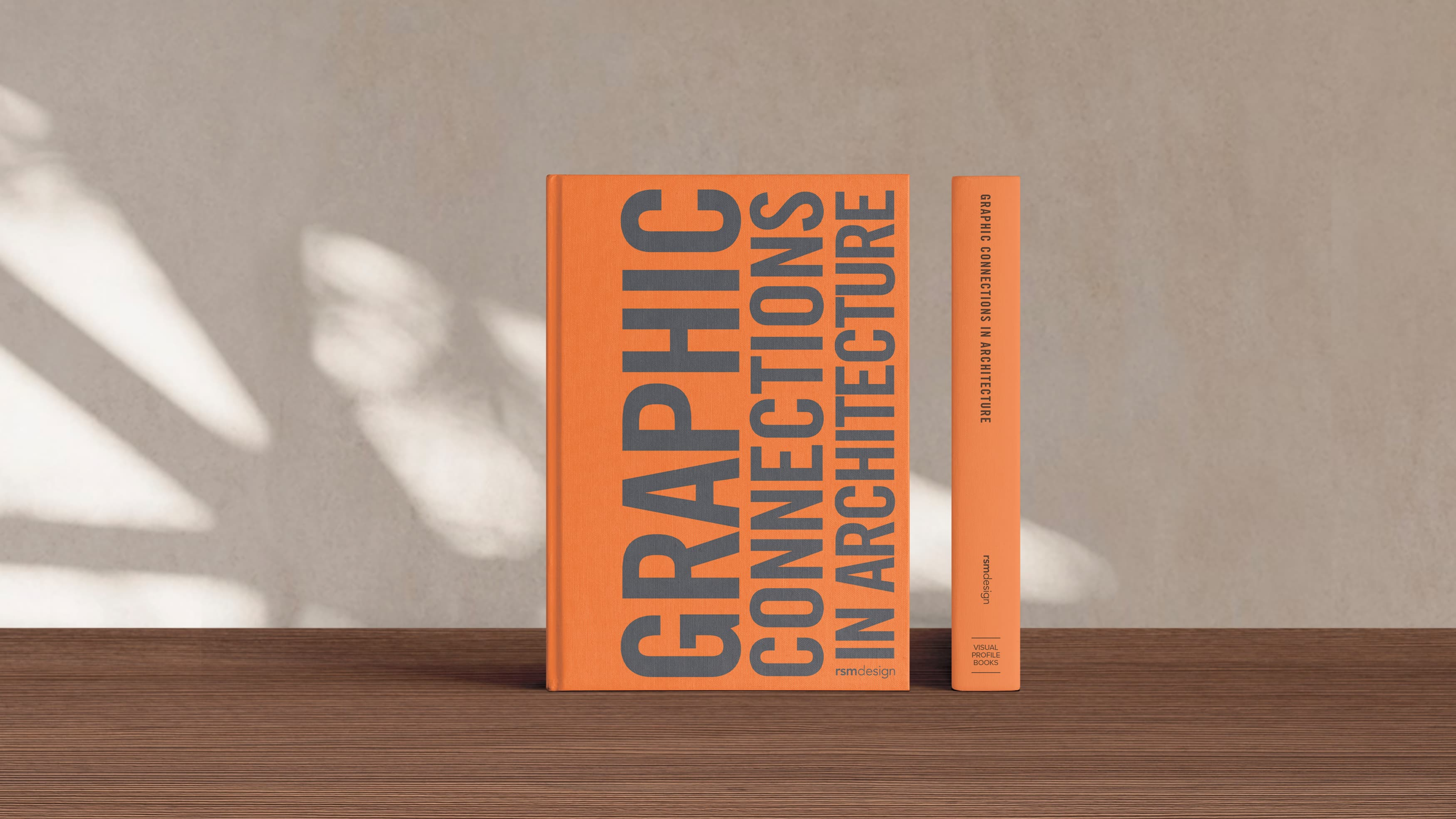 RSM Design's newest book, Graphic Connections in Architecture, sits on a hardwood table.