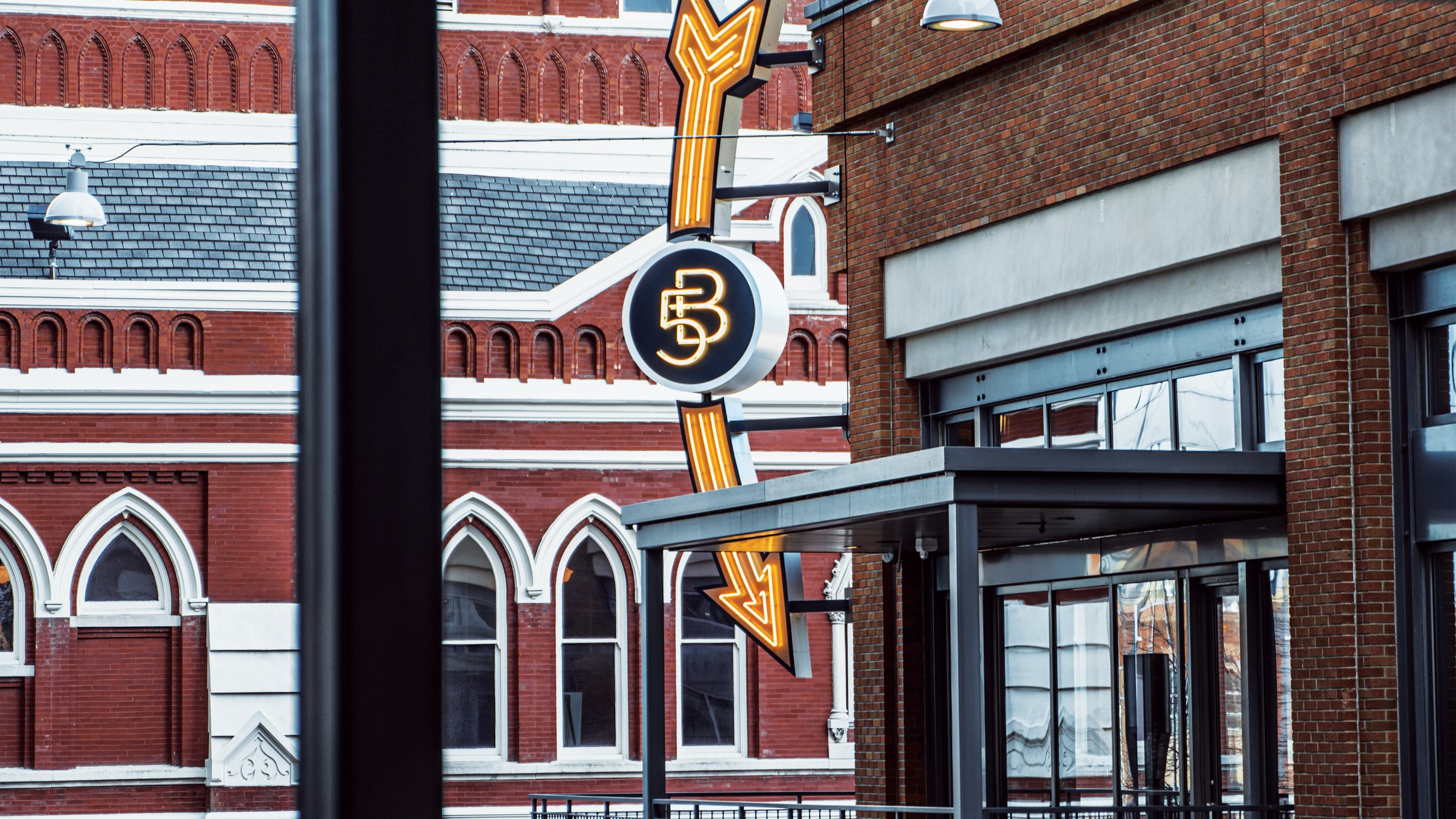 A detailed view of the Fifth and Broadway project identity sign
