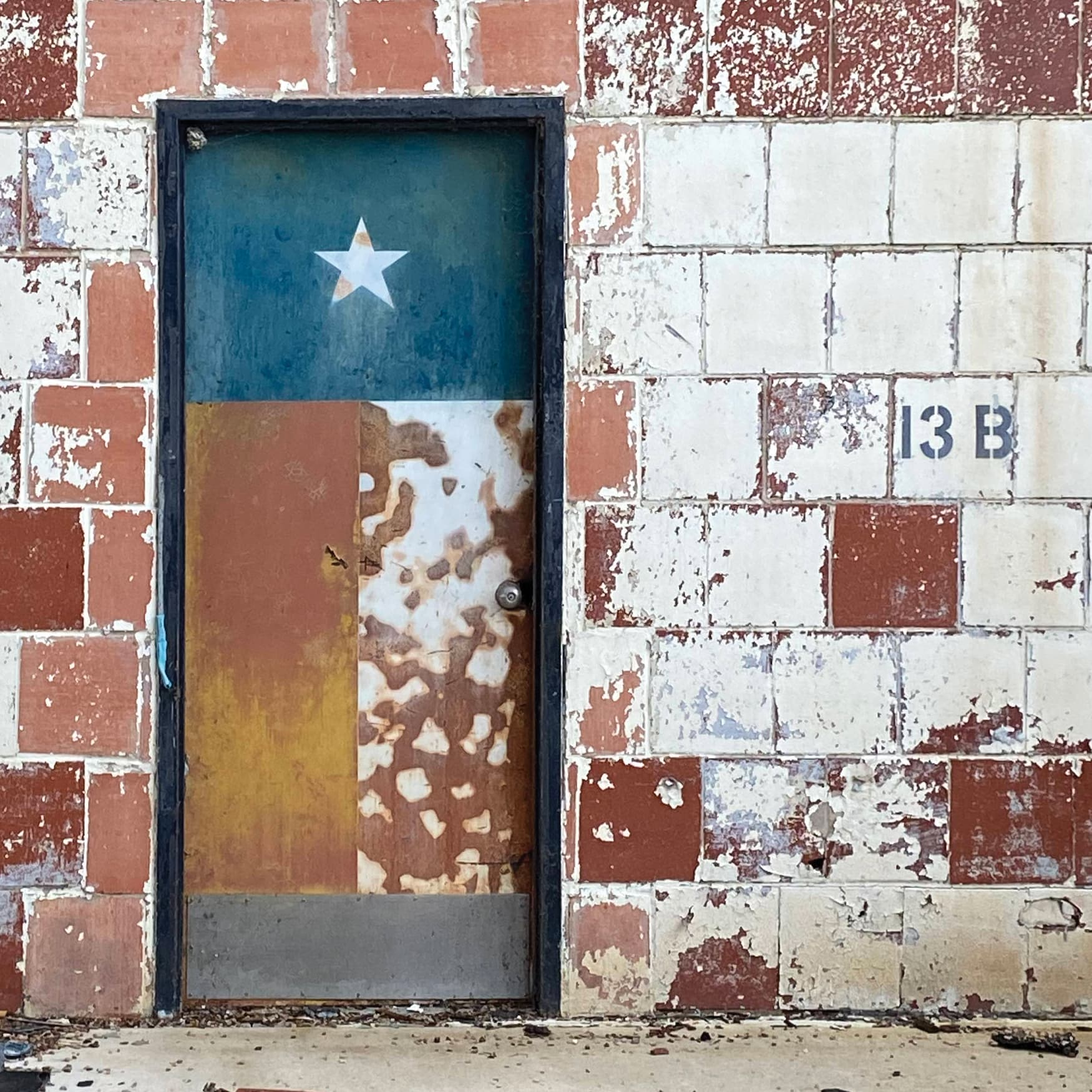 Texas flag painted on the door of an abandoned Navy building at Hensley Field in Dallas, Texas.