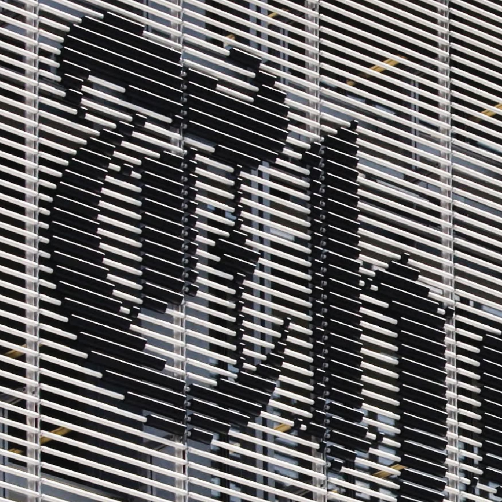 New York Times Building exterior facade signage integrated with the architectural louvers.