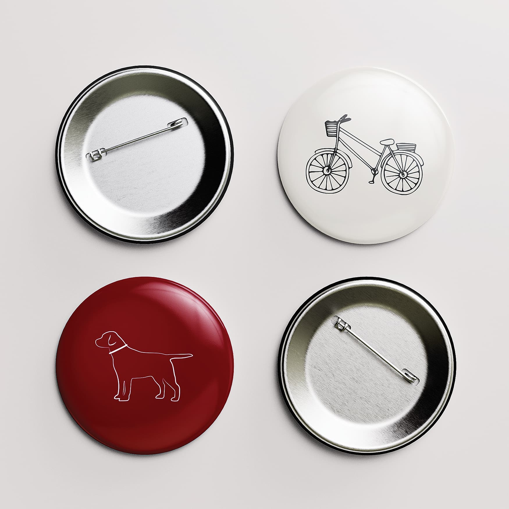 Red and white pins with branded illustrations printed on them.