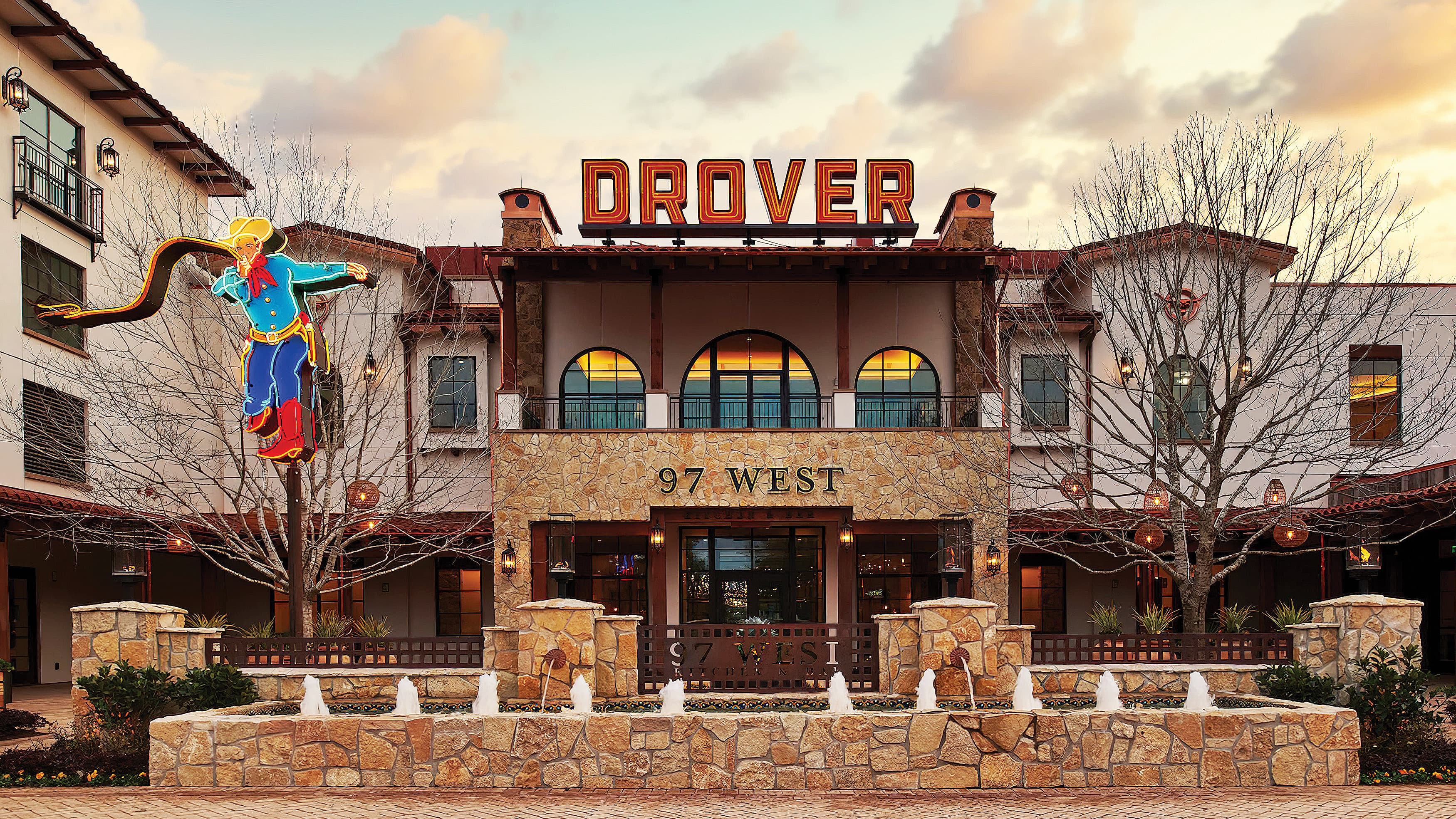 Exterior entrance of Hotel Drover in Fort Worth, Texas with rooftop neon signage design by RSM Design.