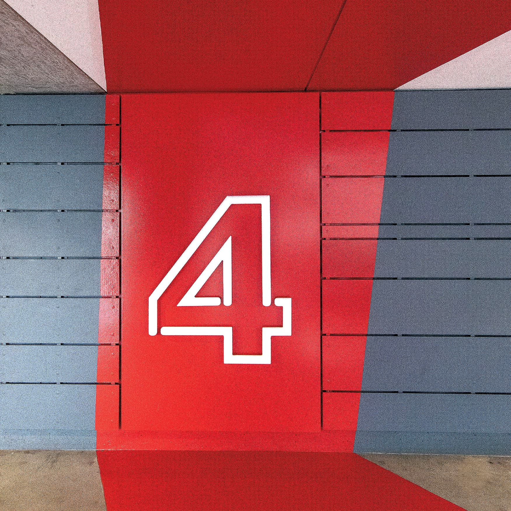 Red painted graphic in a parking garage with the floor number 4.