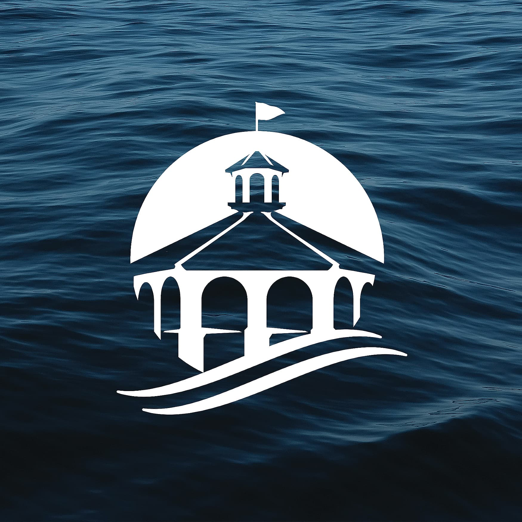 Logo design for Seaport Village over an image of ocean waves.