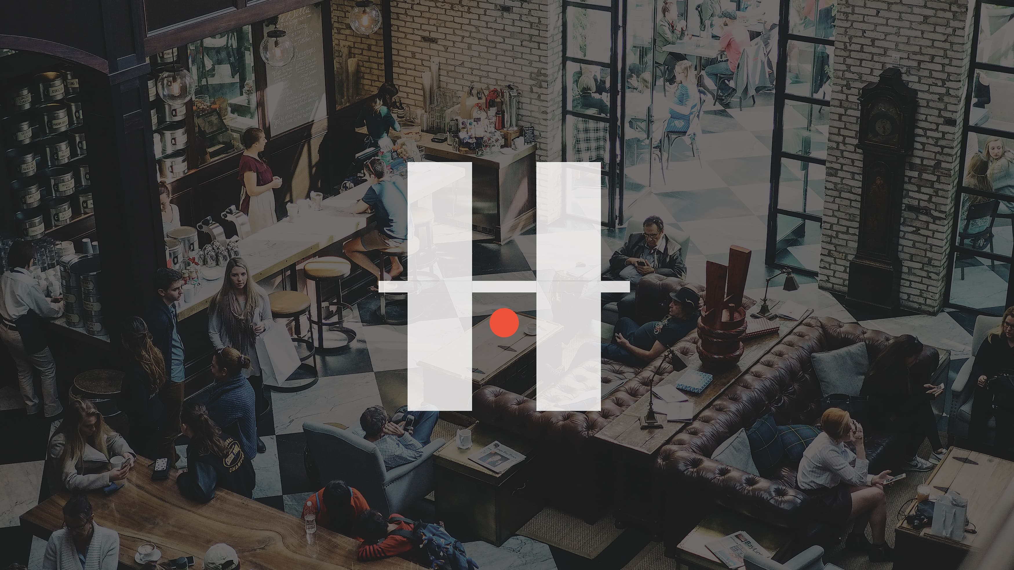 The HART District white logo on an image of people in a cafe.