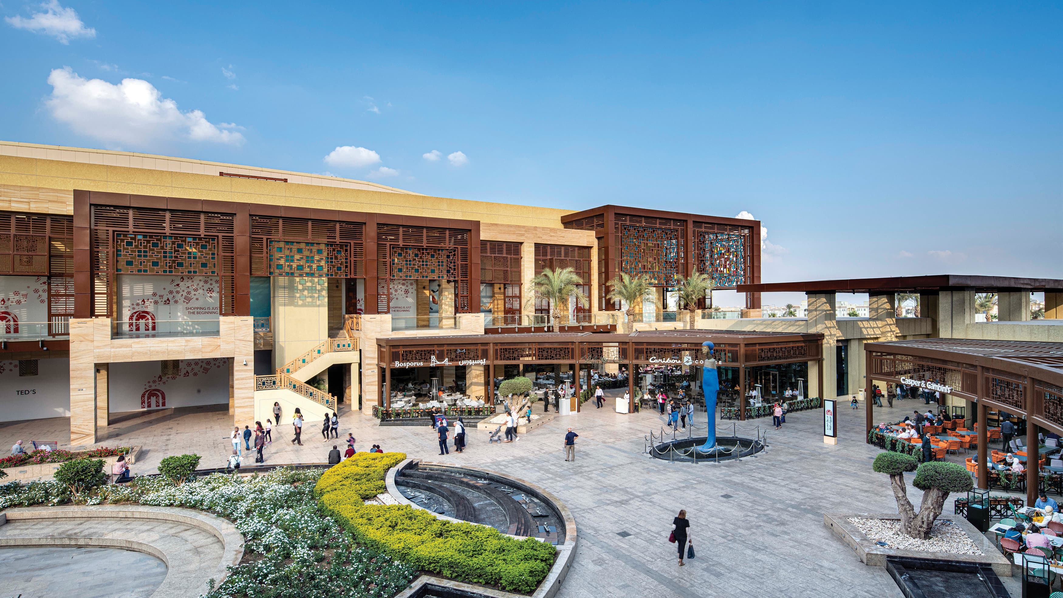 Overhead view of Mall of Egypt's outdoor retail center with monument sign