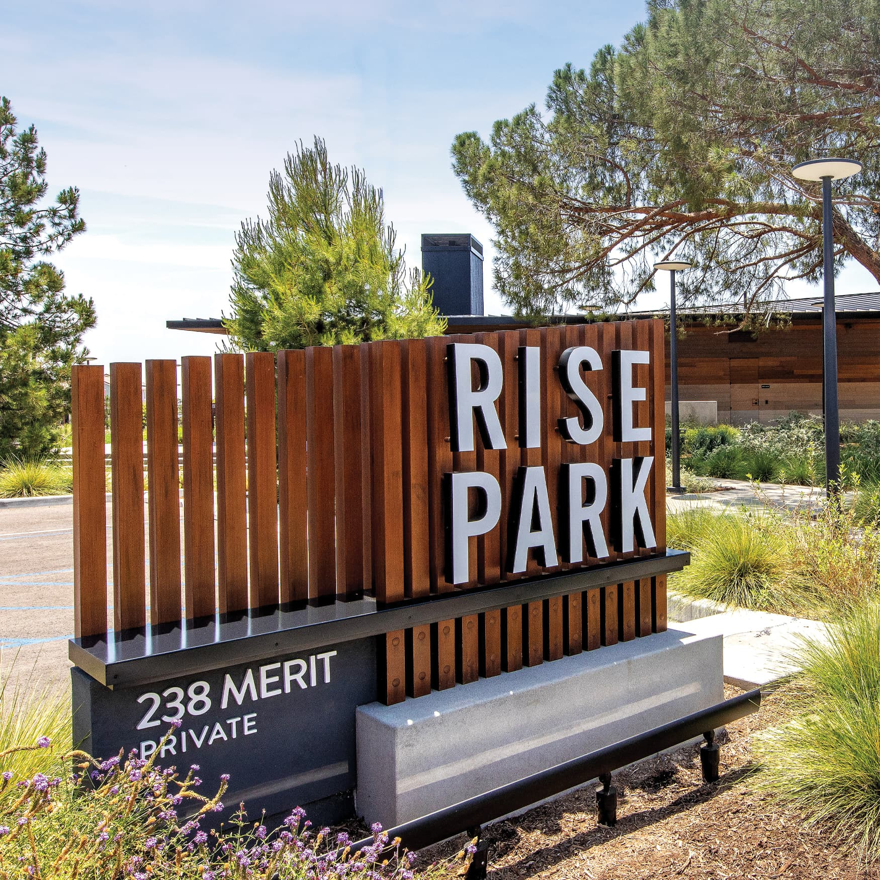 Wooden entrance sign for Rise Park in Irvine, California.
