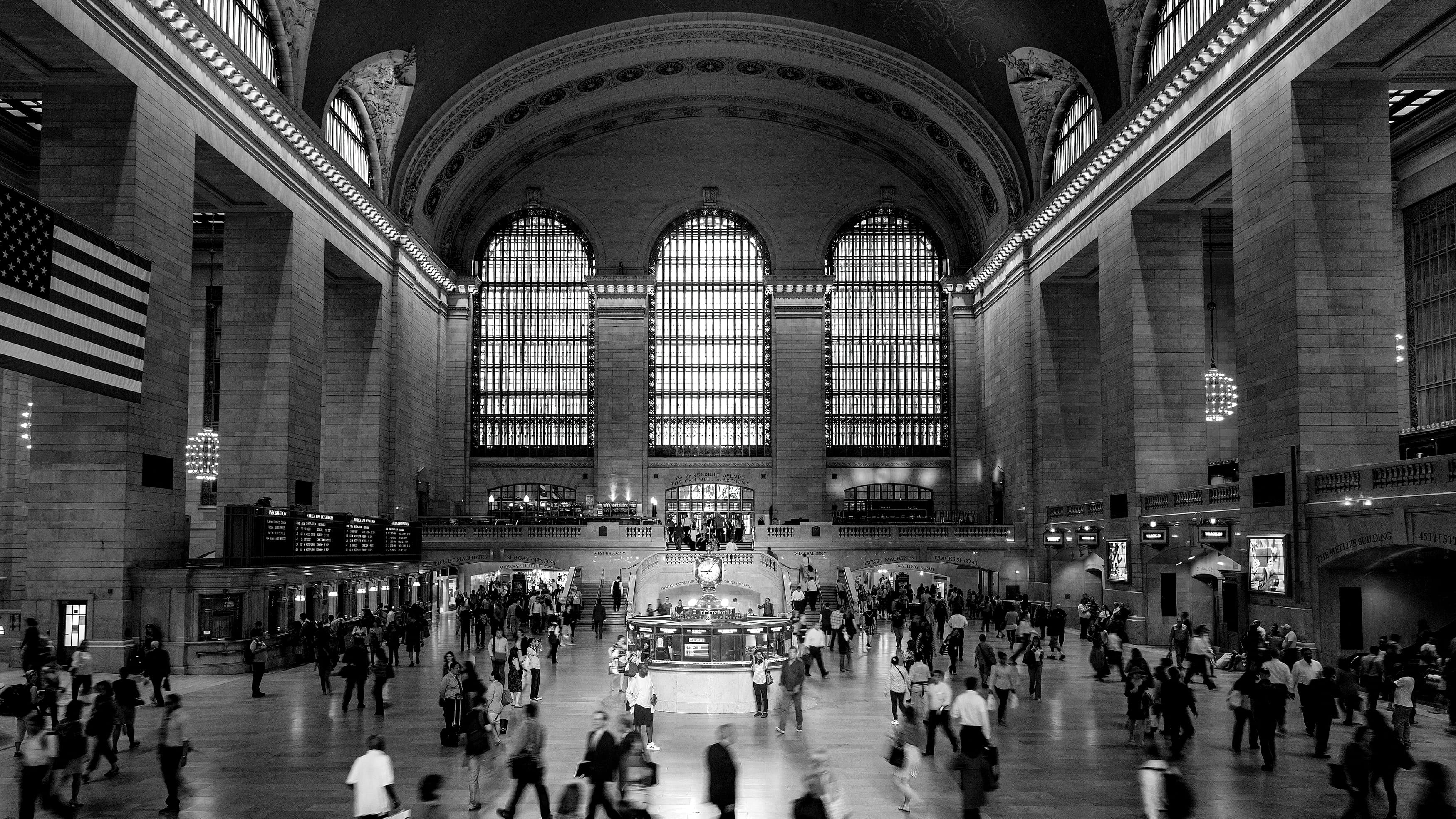 Black and white image of people walking through Grand Central Terminal in New York City