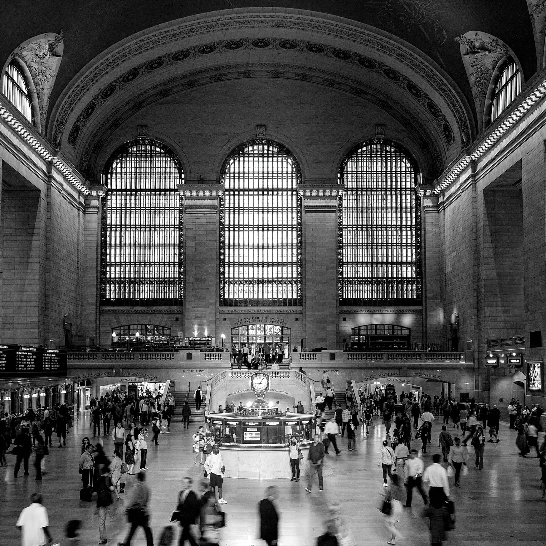 Black and white image of interior of Grand Central Terminal.