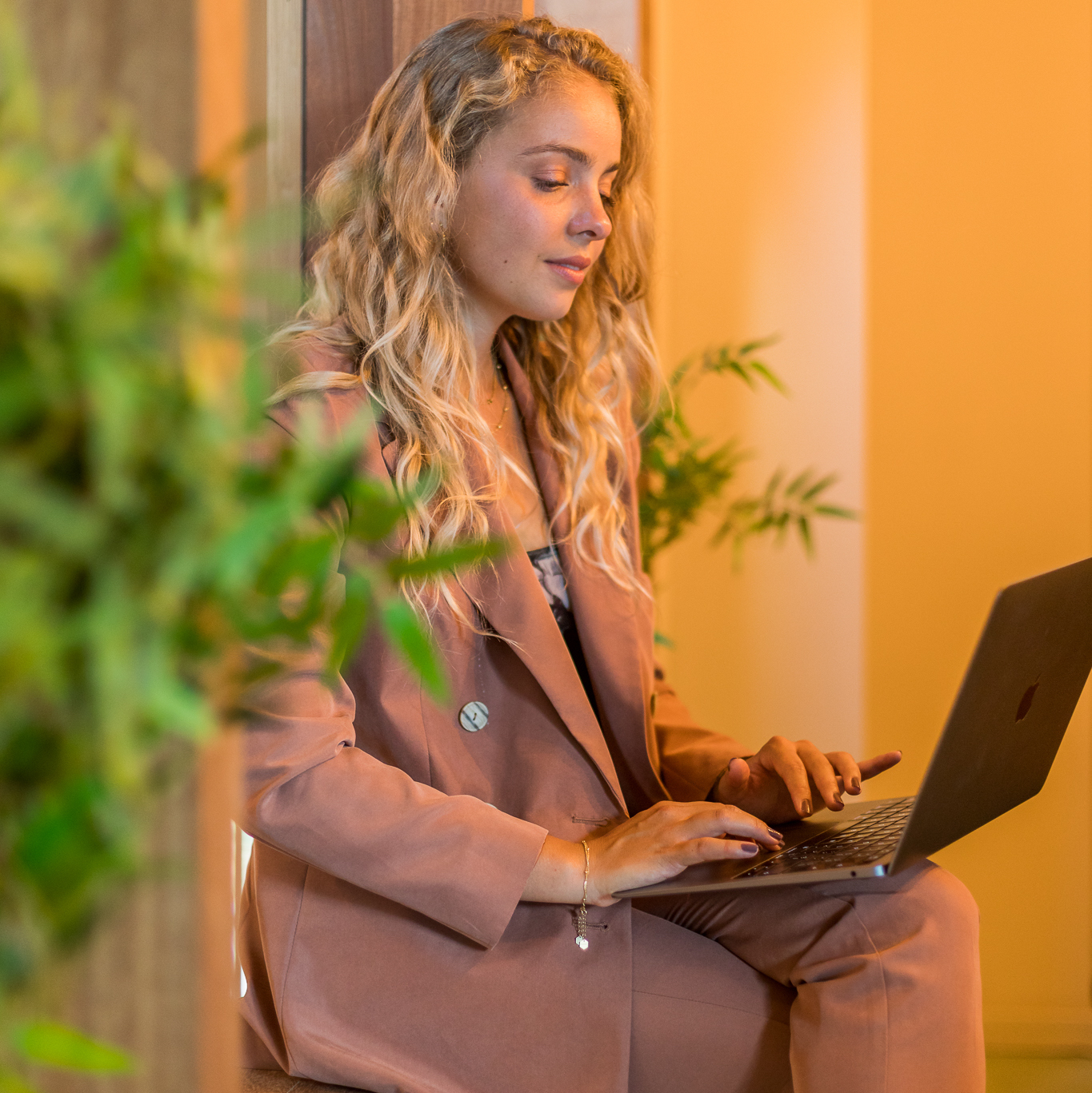Woman looking at laptop on her lap