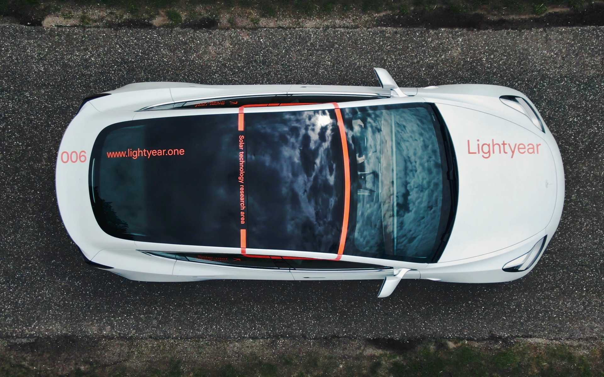 Tesla with solar powered roof, provided by Lightyear