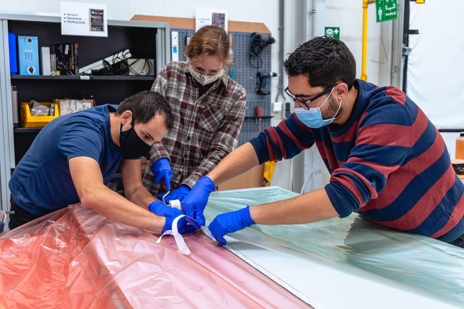 Engineers measuring glass fibre moulds for Lightyear One