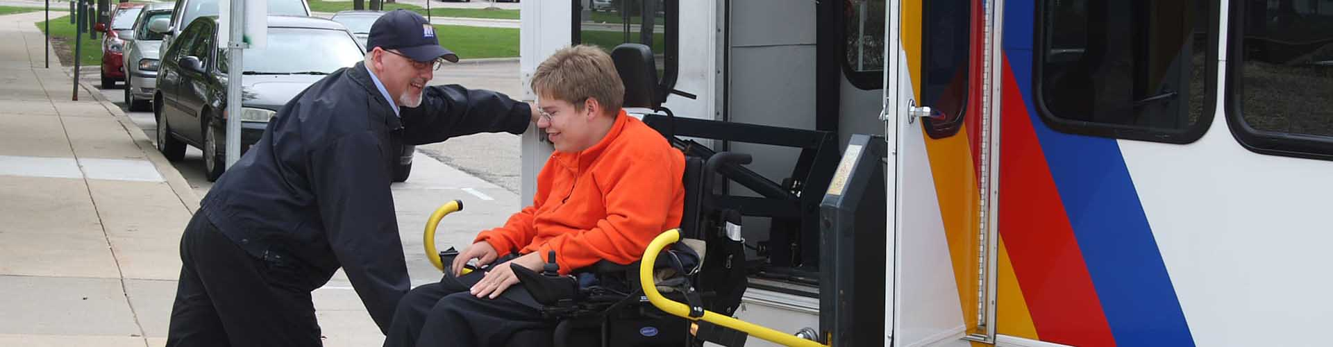 Driver assists passenger in wheelchair de-board transit vehicle