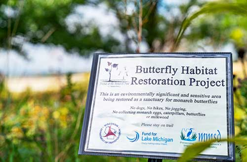 Photo showing sign designating the Butterfly Habitat Restoration Project area that WisDOT helped restore in southeastern Wisconsin