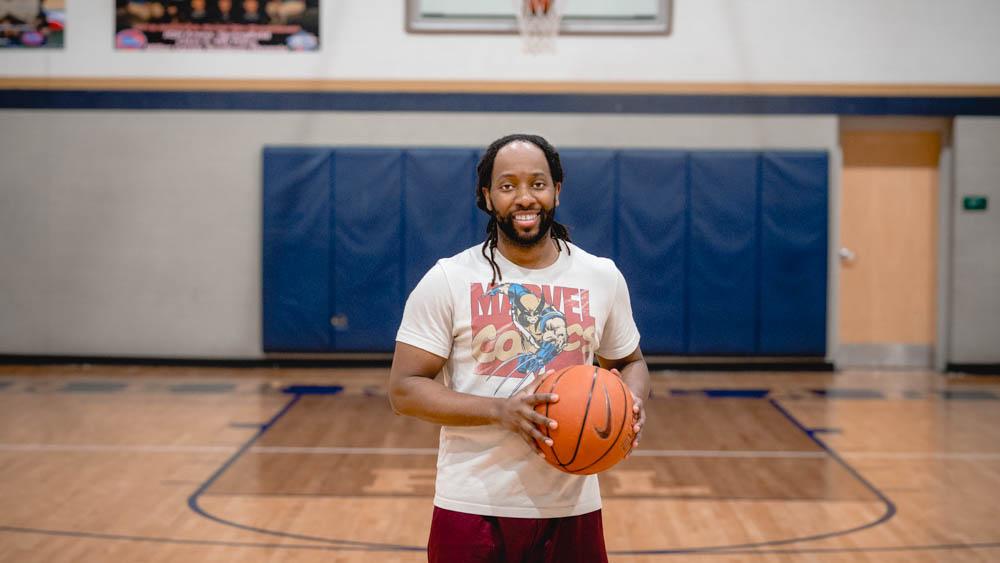 Man holding basketball.