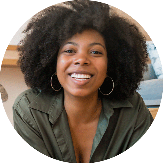 Black woman smiling with natural hair.