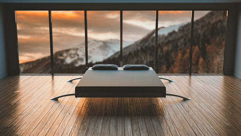 Modern bed frame in empty bedroom with big windows