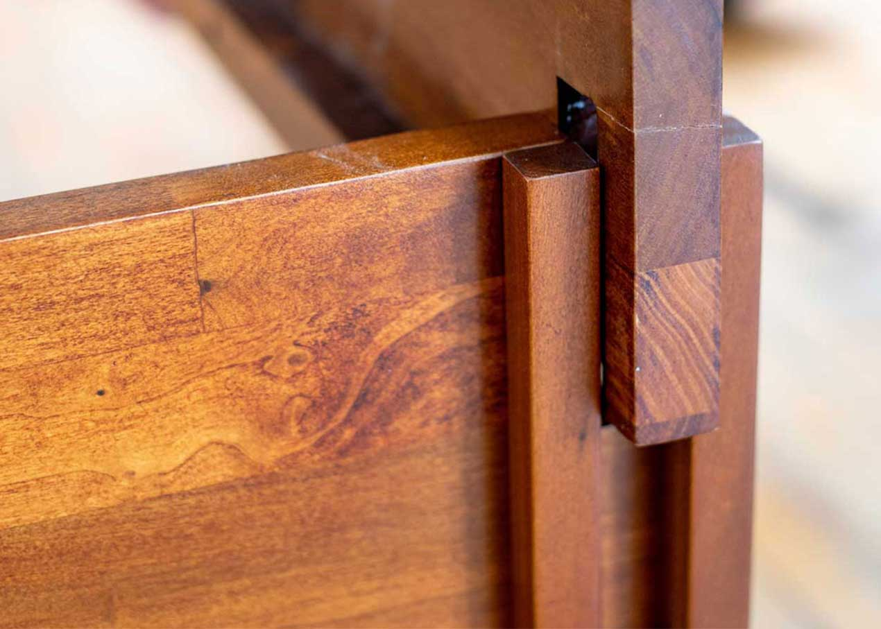 Close up of assembling Rustic bed frame.