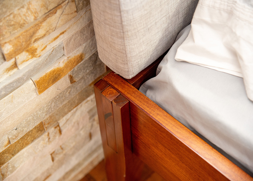 Detailed corner view of Rustic bed frame.