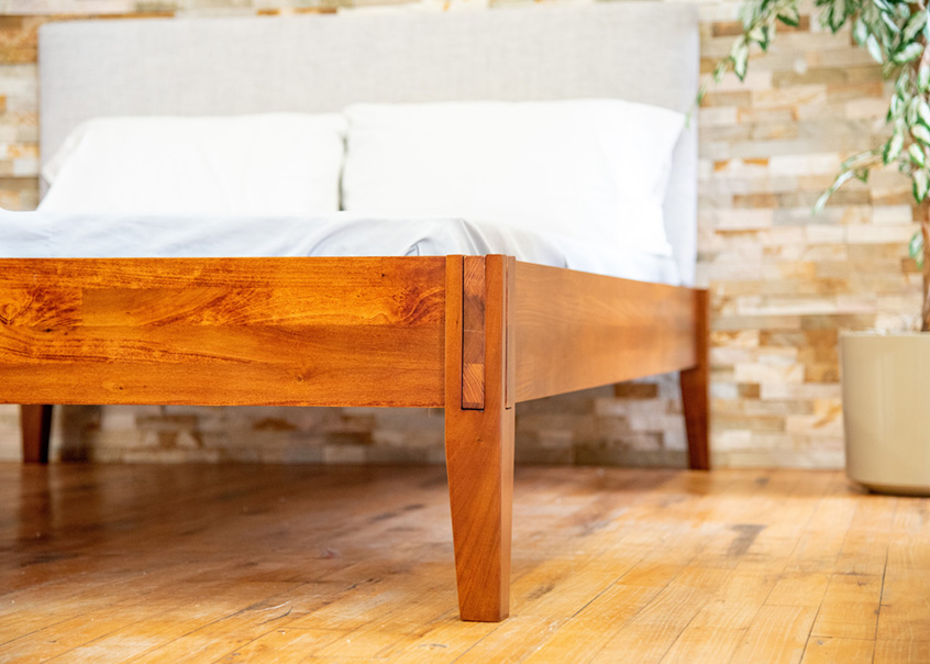 Close up of leg of Rustic bed frame.