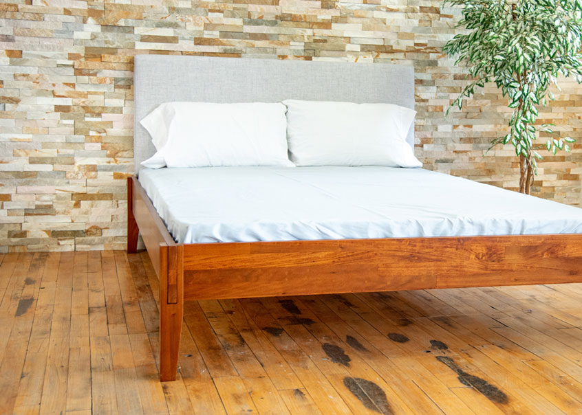 Angled view of Rustic bed frame.