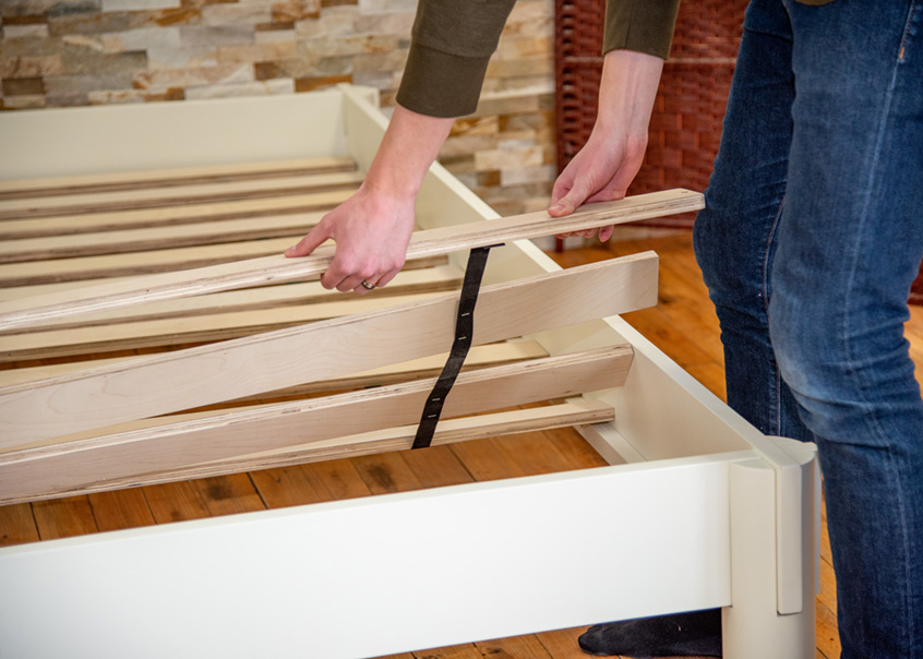 Laying down slats on Urban bed frame.